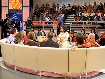 Oprah talks to the show guests.