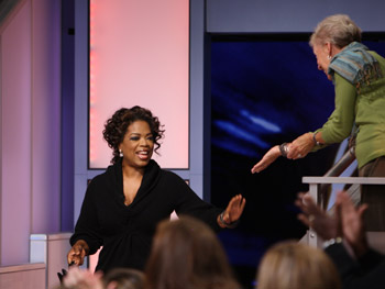 Oprah enters the studio for her interview with Bill Cosby and Dr. Alvin Poussaint.