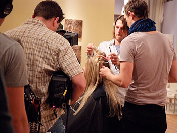Cameras capture the hairstylists doing their work.