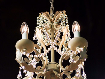 A chandelier hanging in the entrance
