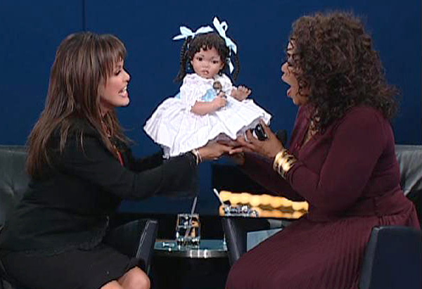 Marie Osmond presents Oprah with a special gift.