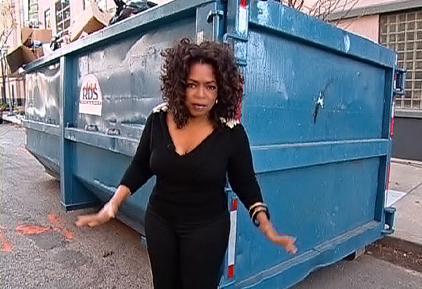 Oprah demonstrate what five tons of garbage looks like.