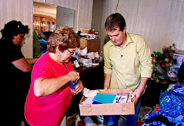 Peter and Sharyrn sort through her possessions.