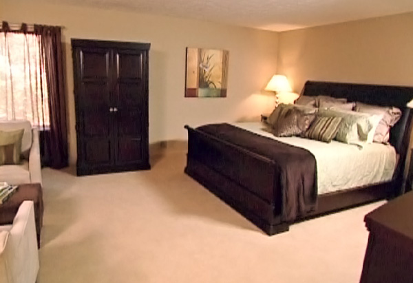 Specific areas are designated for sitting and sleeping in the master bedroom.