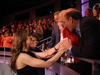 Celine Dion greets some audience members.