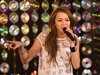 Miley and Oprah surprise 100 of Miley's biggest fans with a live performance.