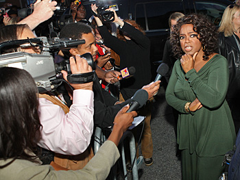 Oprah talks to the press.