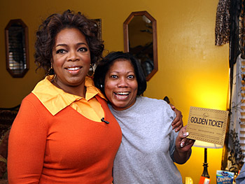Oprah goes door-to-door in Macon.