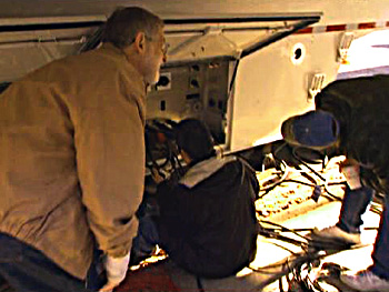The crew scrambles to fix the generator truck.