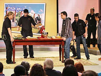 Employees set the stage for a segment with Paula Deen.