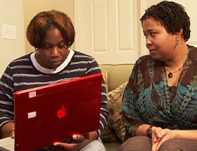 Kelly and Nicole look at Kelly's credit score.