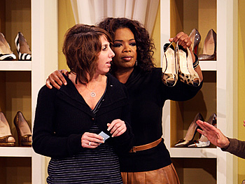 Oprah helps an audience member select shoes.