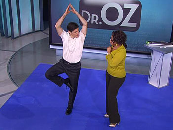 Dr. Oz demonstrates yoga.