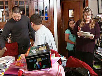 Amber and her family start cleaning their home.