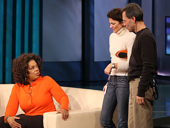 Oprah talks with her stylist, Kelly, and the stage manager, Dean.