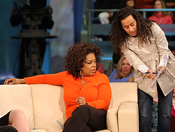 During a break in taping, 'Oprah Show' producer Andrea comes onstage to discuss the show plan.