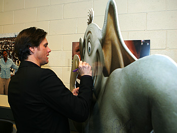 Jim Carrey signs a cutout of Horton.