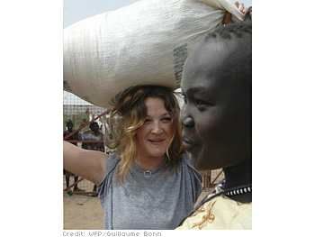 Drew Barrymore carries a food sack on her head.