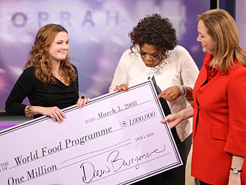Drew Barrymore gives a donation to Josette Sheeran from the World Food Program.