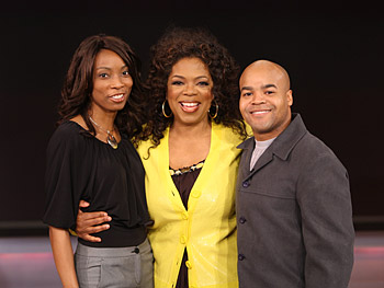 Angelo poses for a photo with Oprah.