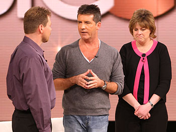 Simon Cowell surprises Randy and Amy.