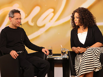 Stage manager Dean sits with Oprah before the show starts.