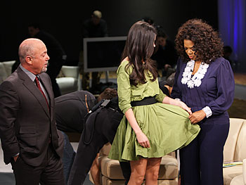 Oprah compliments Katie Joel's dress.