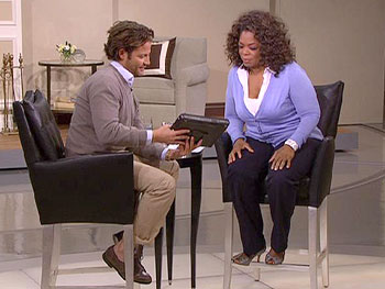 Nate and Oprah check out the Control4 system.