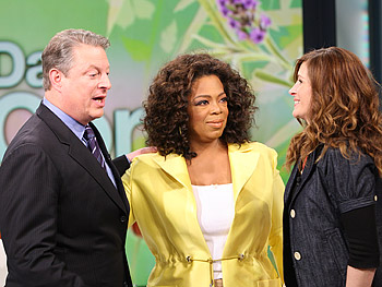 Oprah introduces Al Gore to Julia Roberts.