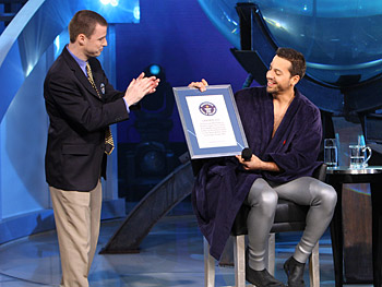 Stuart Claxton presents David Blaine with a plaque.