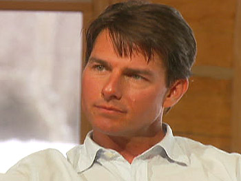 Tom Cruise talks about his wife's pregnancy.