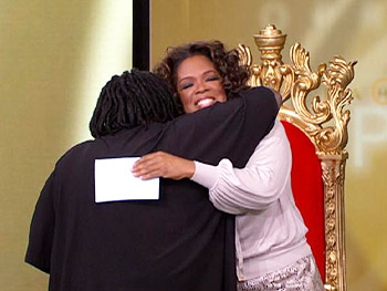 Oprah hugs Fannie.