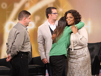 Oprah greets Sharyn and Marvin's daughter.