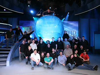 Crew members pose with David Blaine's water tank.
