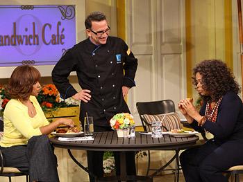 Oprah eats a catfish sloppy joe.