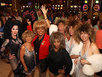 Tina Turner and Cher impersonators line up outside Caesars Palace.