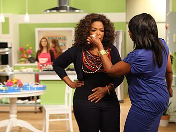 Oprah gets a makeup touch-up.