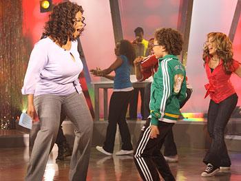 Quincy Eaton teaches Oprah the 'Cha-Cha Slide.'