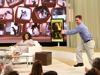 Bryan busts a move on Oprah's stage.