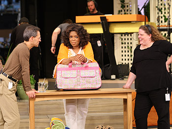 Oprah meets with a show producer and the stage manager