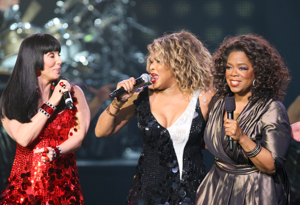 Oprah on stage with Cher and Tina Turner