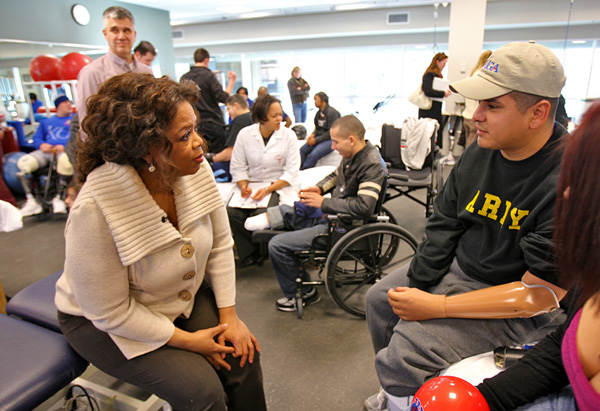 Staff Sgt. Ramon Padilla talks with Oprah.