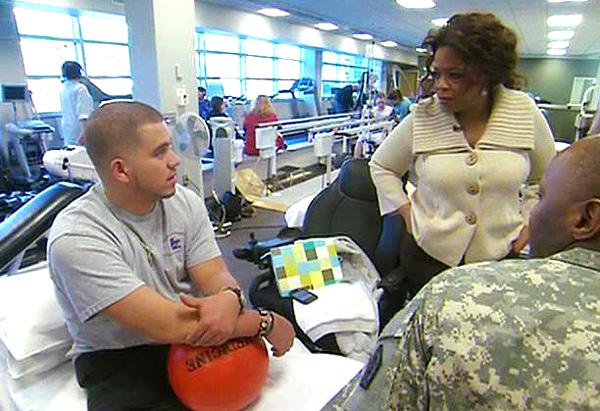 Oprah meets Staff Sgt. Juan Roldan.