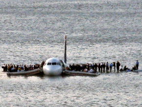 Flight 1549 lands on the Hudson River.