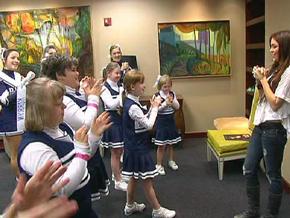 Sparkles cheerleaders meet Miley Cyrus.