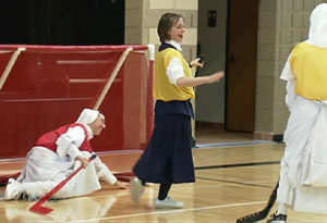 Nuns playing field hockey