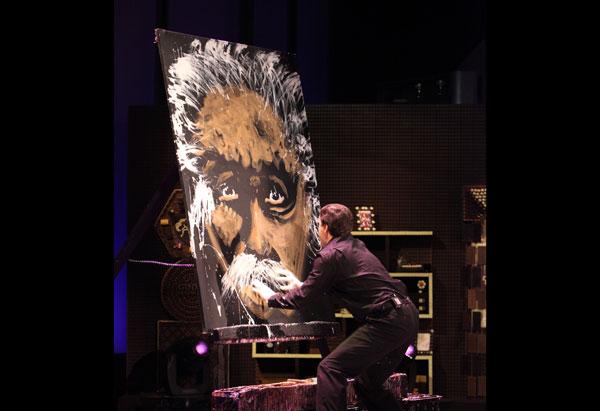 Rob Surette paints a portrait.