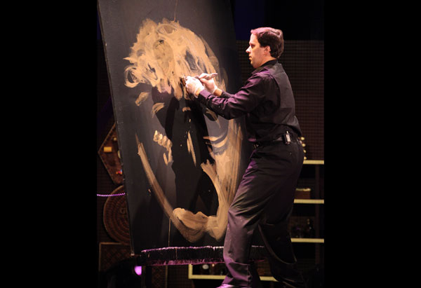 Rob Surette paints a portrait.