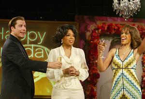 John Travolta toasting Oprah.