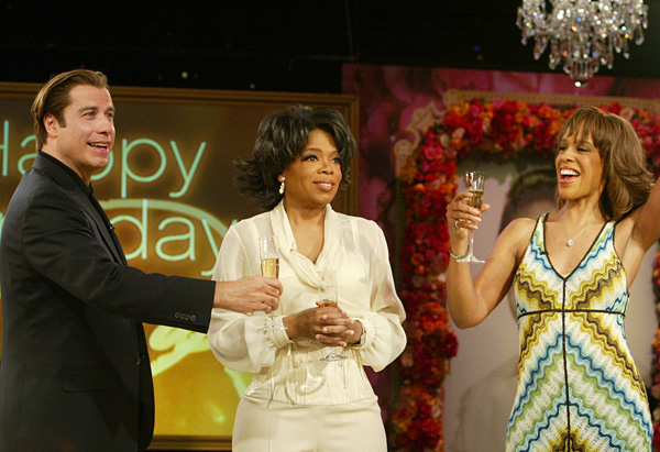 John Travolta and Gayle King toast to Oprah.